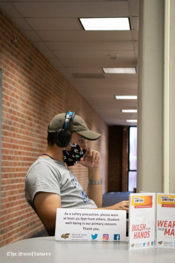 Sophomore, Pedro Cupertino is studying in the Ablah Library. The library has been practicing social distancing by working at least six feet away from others and distancing close proximity computer usage.