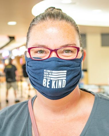 Junior Andrea Baker smiles for a photo with her mask on Monday, August 17 inside the RSC.