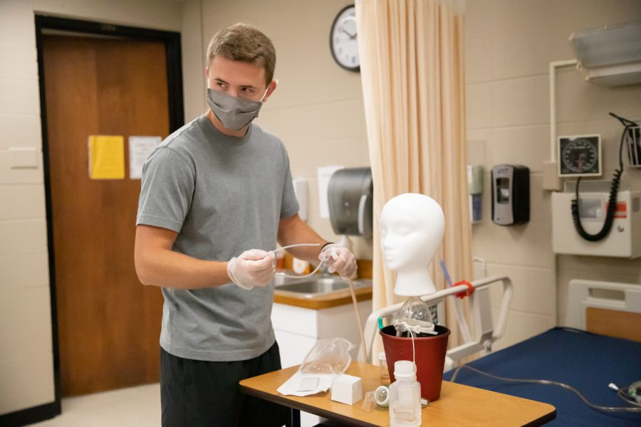 A WSU Nursing student demonstrates how to help a patient that has symptoms of respiratory problems. The students talk to the mannequins to ensure they are ready and capable of practicing real life situations.