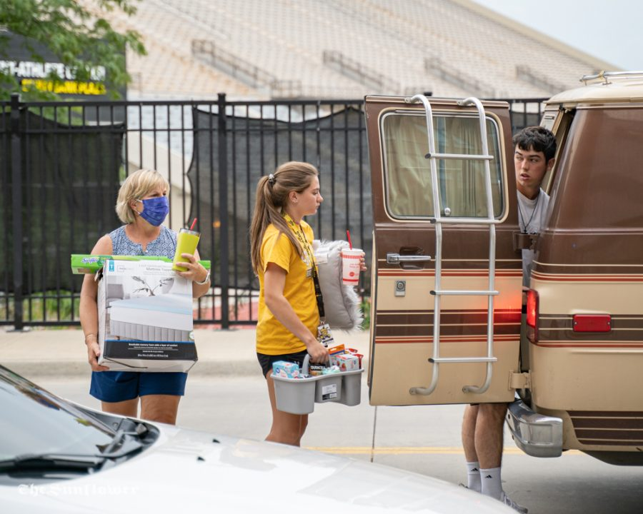 More than 1,000 students are moving into Shocker Hall, The Flats and The Suites this month. The university added safety precautions to keep residents distanced and masked while moving in.