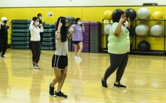 KVersity dance members practicing their latest dance at the Heskett center, Room 141, on Saturday.