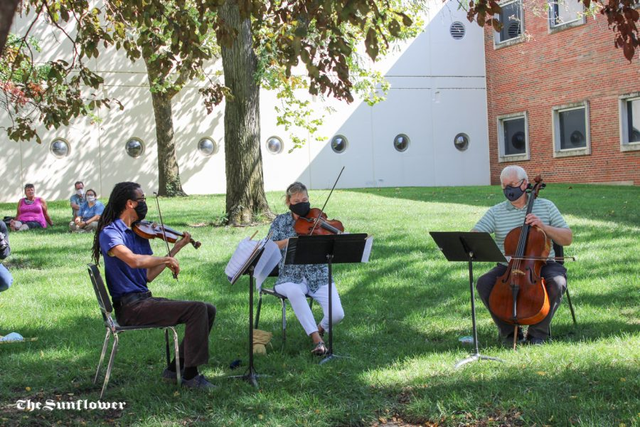 The Fairmount String Trio performing at a mini Pop-Up concert in between Wiedemann Hall and Duerksen Fine Arts Center on Friday, Sept. 25.