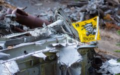 A Wichita State flag sits atop a pile of twisted metal remains from the 1970 WSU plane crash near Silver Plume, Colorado.
