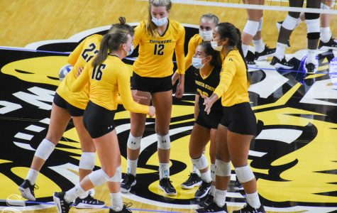 Wichita State's yellow team goes in for a huddle during the Black and Yellow Scrimmage on Saturday, Sep. 12.