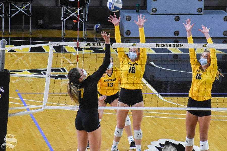 Wichita State sophomore Nicole Anderson attacks the net while freshmen Marriah Buss and Lauren Mcmahon prepare to block during the Black and Yellow Scrimmage on Saturday.