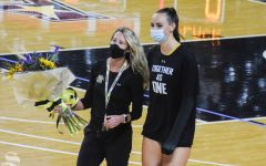 Wichita State senior Emma Wright walks with Director of Operations Shannon Lamb during her senior recognition during the Black and Yellow Scrimmage on Saturday, Sept. 12 inside Charles Koch Arena.