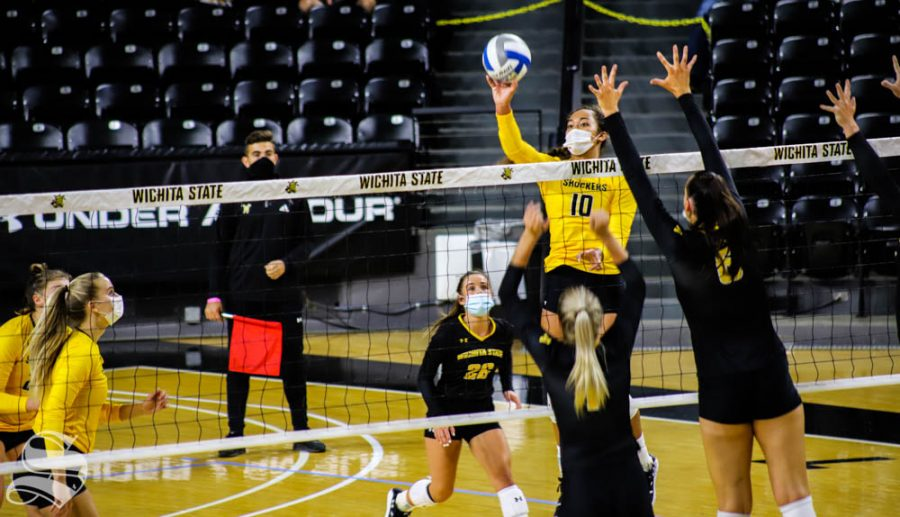 Wichita State Sophomore Sinalaulii Uluave tips the ball over to the opponents team during the Black and Yellow Scrimmage on Sept. 12 at Charles Koch Arena.