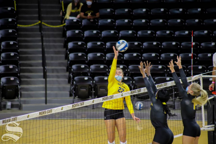 Wichita State freshman Morgan Webber spikes the ball during The Black and Yellow Scrimmage.