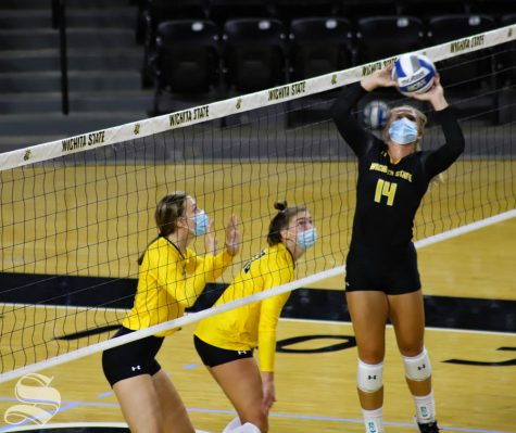 Wichita State senior McKayla Wuensch sets the ball to her teammate during a scrimmage on Sept. 12 inside Charles Koch Arena.