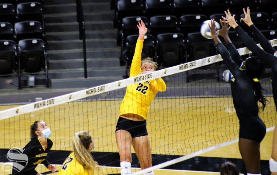 Wichita State freshmen Morgan Weber spikes the ball during Black and Yellow Scrimmage at Charles Koch Arena.
