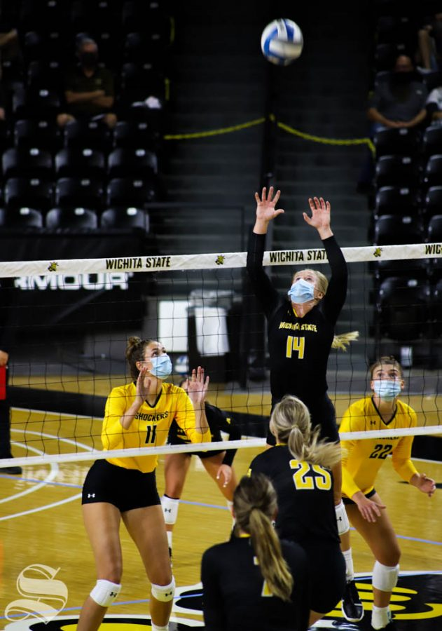 Wichita State senior McKayla Wuensch sets the ball to her teammate during a scrimmage on Sept 12 inside Charles Koch Arena.