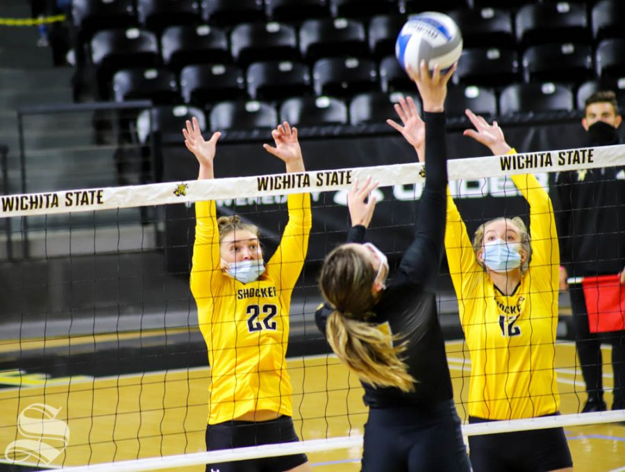Wichita State freshmen Morgan Weber and Lauren McMahon block the ball during Black and Yellow Scrimmage at Charles Koch Arena.
