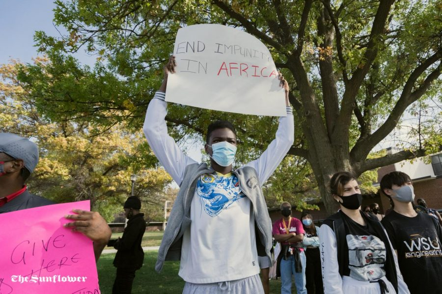 A member of the African Student Associasion holds up a sign during the protest.
