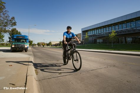 Officer Matthew Feldt rides a bike patrolling campus. The campus police hope this program will grow and make them more approachable for students as well as demonstrate bike safety on campus.
