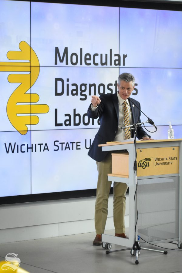 Interim President Rick Muma points to the county commissioners during the opening of the new Molecular Diagnostics Lab on Monday inside the John Bardo center on Innovation Campus.