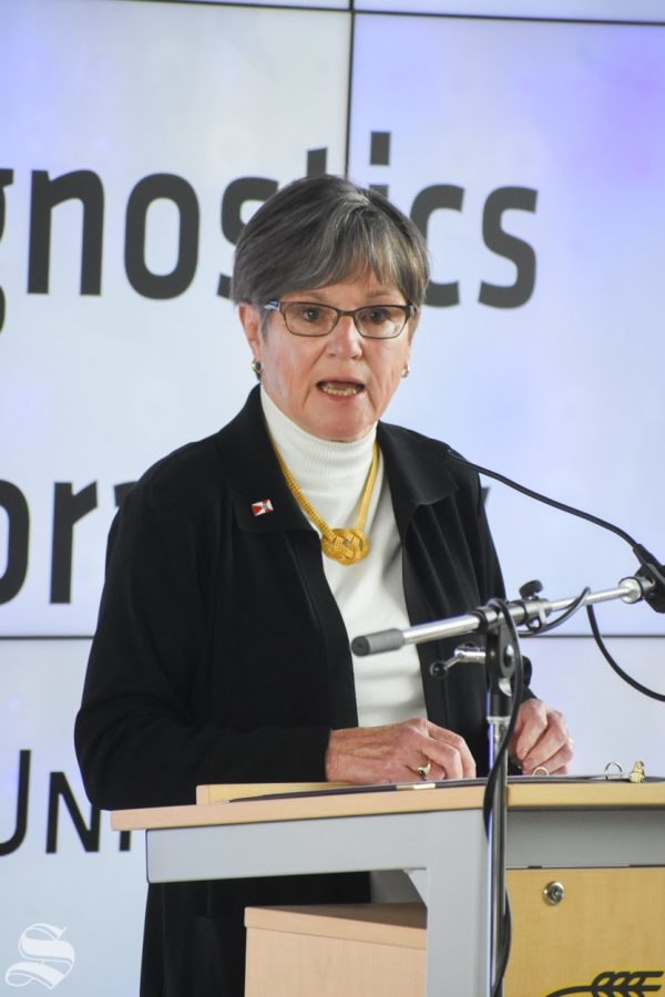 Laura Kelly, Governor of Kansas, speaks during the opening announcement of the new Molecular Diagnostics Lab at Wichita State on Monday, Oct. 19.