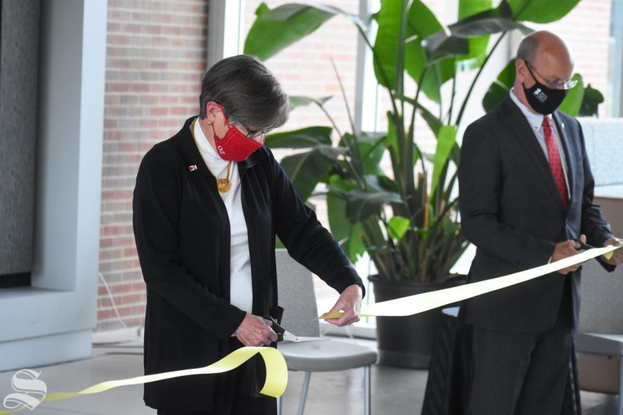 Governor of Kansas Laura Kelly cuts the ribbon to open the new Molecular Diagnostics Lab on Monday, Oct. 19 inside the John Bardo Center.