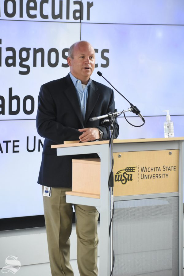 Wichita State's John Tomlin speaks about the new molecular diagnostics lab on Monday, Oct. 19 inside the John Bardo Center.