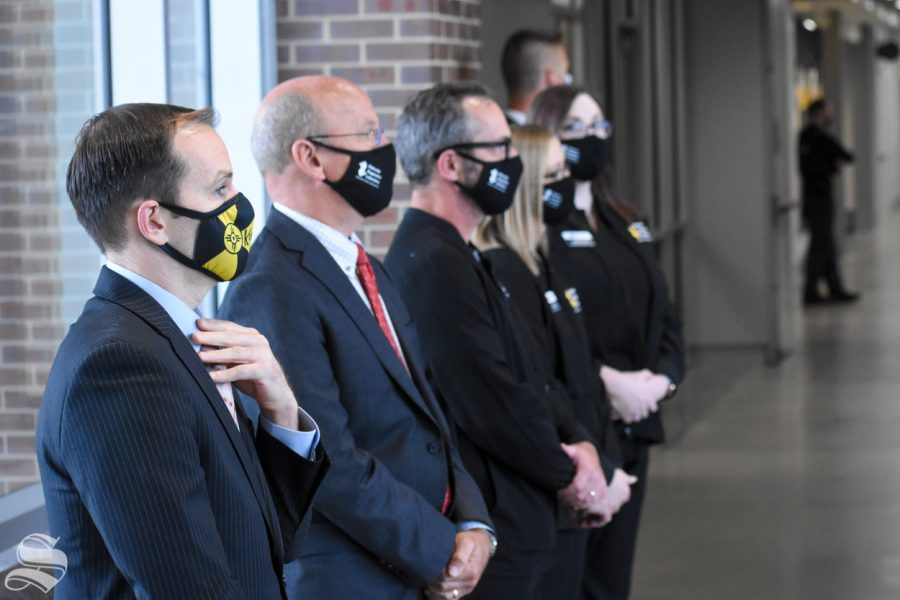 Wichita mayor Brandon Whipple and Sedgwick County Commissioner chairman Pete Meitzner stand among others during the opening of the new Molecular Diagnostics Laboratory on Monday inside the John Bardo Center.