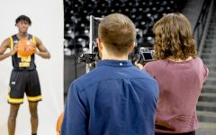 Sunflower photographers Easton Thompson and Morgan Anderson cover men's basketball media day on Oct. 15, 2019 inside Charles Koch Arena.