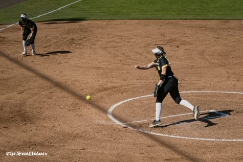 Wichita State junior Caitlin Bingham makes a pitch during the scrimmage at Wilkins Stadium on Oct. 3, 2020.