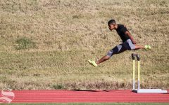 Wichita State junior Yuben Goncalves jumps over a hurdle during a scrimmage on Friday, Oct. 30 at Cessna Stadium.