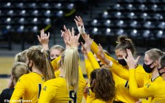 Team yellow gathers together during a break at the Black vs. Yellow scrimmage on Oct.1 at Koch Arena.