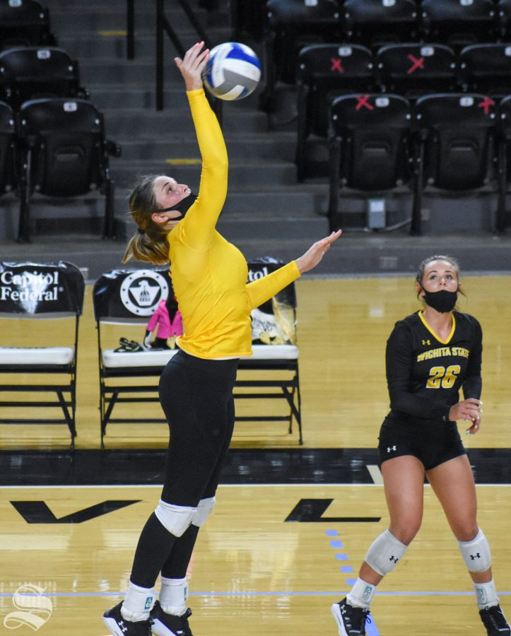 Wichita State sophomore Nicole Anderson hits the ball behind the 10-foot line during the third set of the Black and Yellow Scrimmage on Friday.