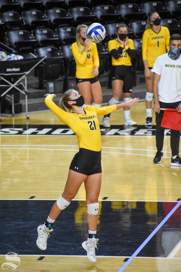 Wichita States Megan Taflinger serves the ball during the Black and Yellow Scrimmage on Friday inside Charles Koch Arena.