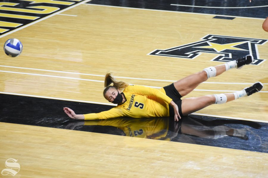 Sophomore Kayce Litzau dives for ball during the Black and Yellow Scrimmage on Friday, Oct. 16 inside Charles Koch Arena.
