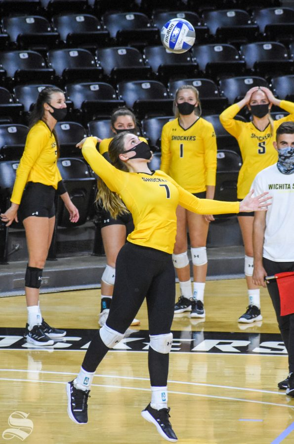 Wichita State sophomore Nicole Anderson serves the ball to the black team during the scrimmage on Friday inside Charles Koch Arena.
