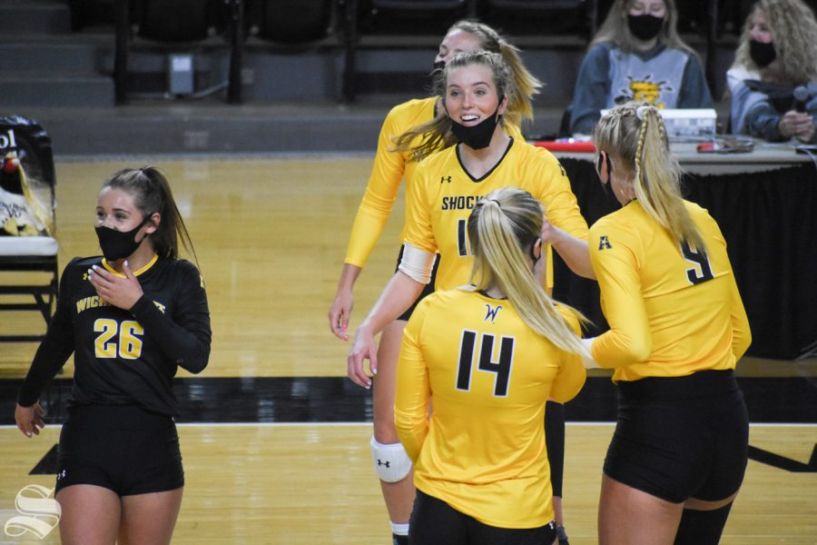 Wichita State freshman Lauren McMahon celebrates with her team after scoring against the black team on Friday, Oct. 16.