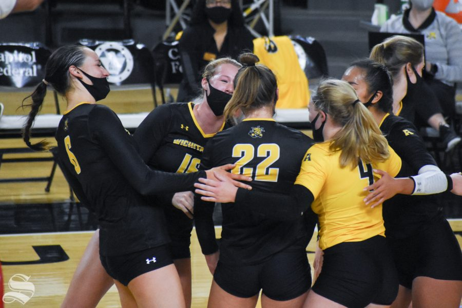 The black team celebrates after scoring against the yellow team in the third set on Friday, Oct. 16.