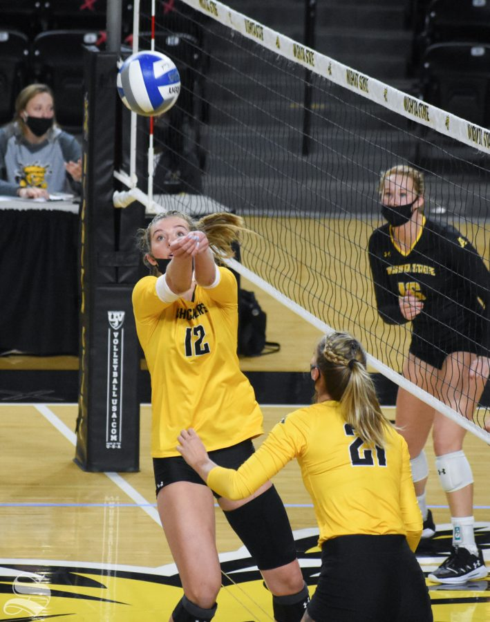 Freshman Lauren McMahon passes the ball off the net during the Black and Yellow Scrimmage on Friday.