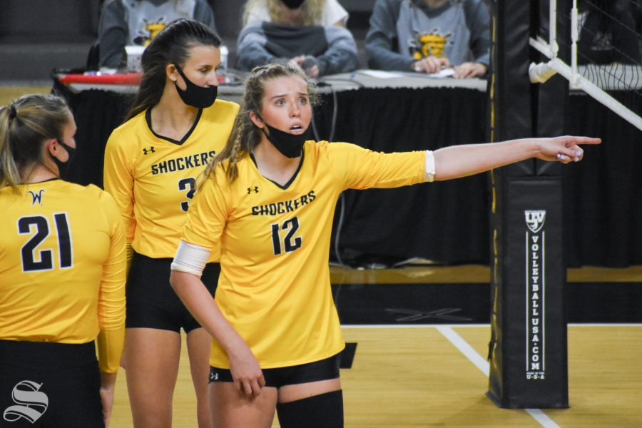 Freshman Lauren McMahon questions a call made by the referee during the third set of the Black and Yellow Scrimmage on Friday inside Charles Koch Arena.