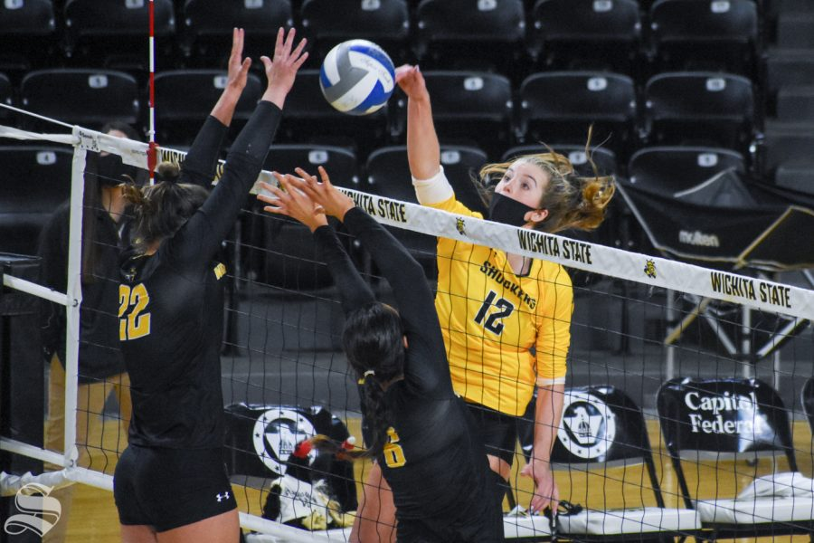 Wichita States Lauren McMahon spikes the ball to the black team while Morgan Weber and Emma Wright prepare to block during the Scrimmage on Friday.