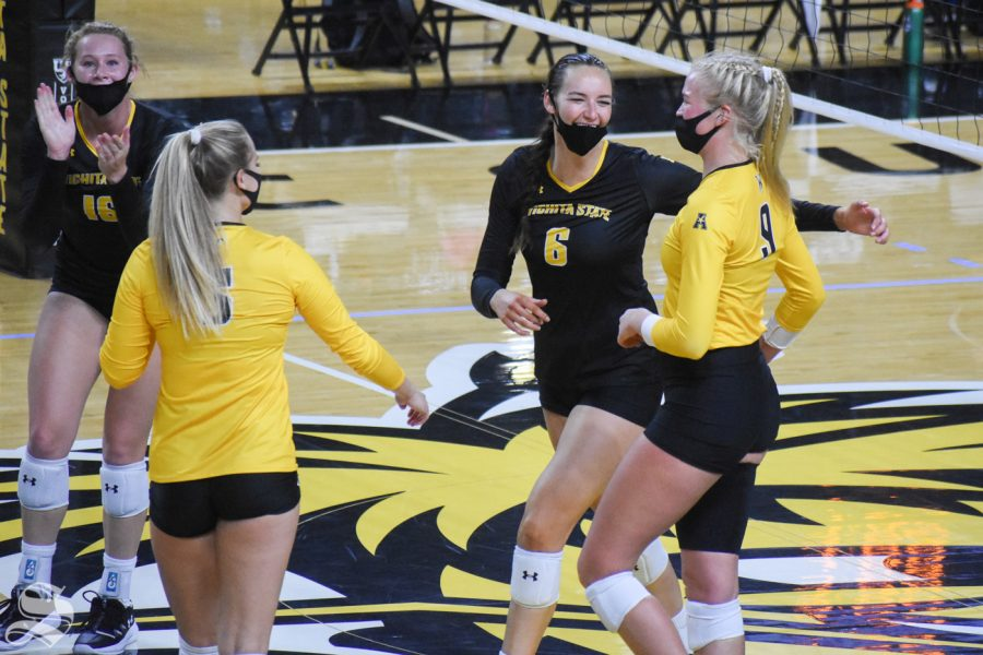 Wichita States Emma Wright smiles and celebrates with her teammates after scoring against the yellow team on Friday inside Charles Koch Arena.
