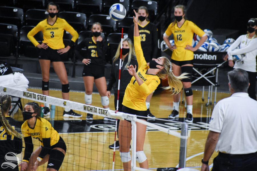 Redshirt freshman Skylar Goering goes up for a spike during the third set of the Black and Yellow Scrimmage on Friday inside Charles Koch Arena. The black team won the scrimmage 3-2.
