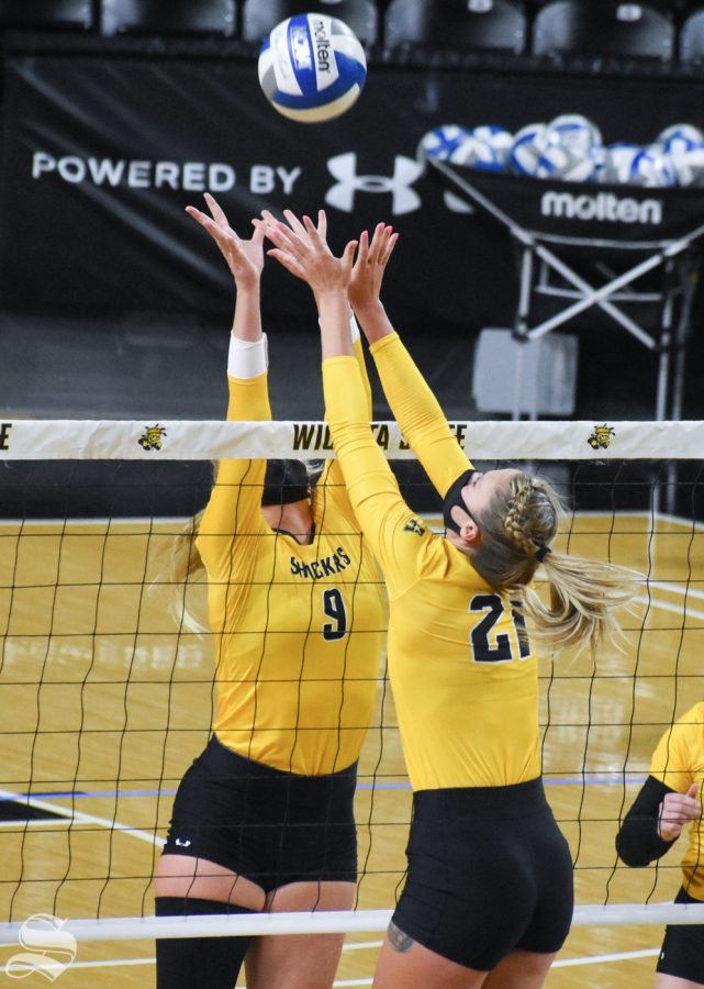 Wichita States Sophie Childs and Megan Taflinger battle at the net for a tip ball during the Black and Yellow Scrimmage on Friday inside Charles Koch Arena.