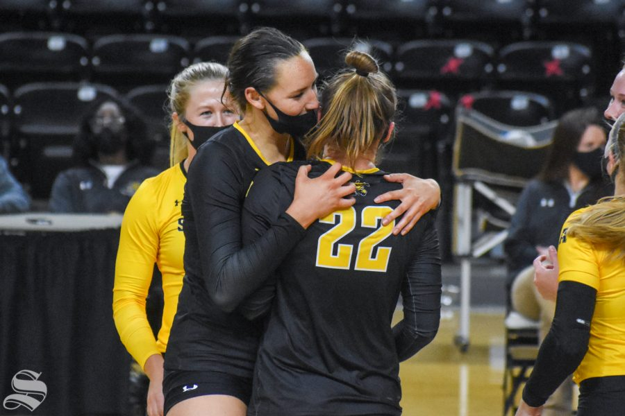 Wichita States Emma Wright hugs freshman Morgan Weber after scoring against the yellow team during the scrimmage on Friday.