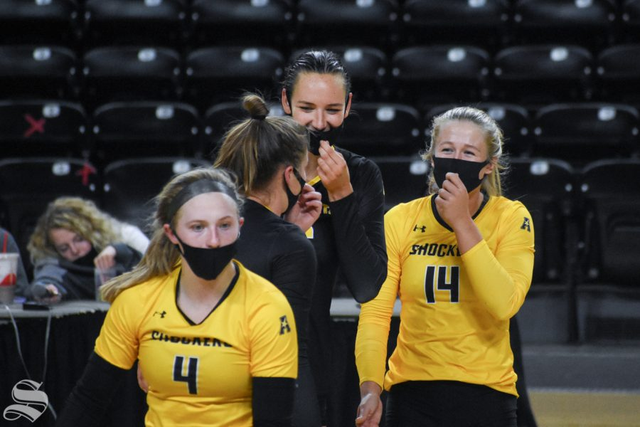 Wichita States Emma Wright, McKayla Wuensch, and Morgan Weber laugh together after scoring against the yellow team during the Black and Yellow Scrimmage on Friday, Oct. 16.