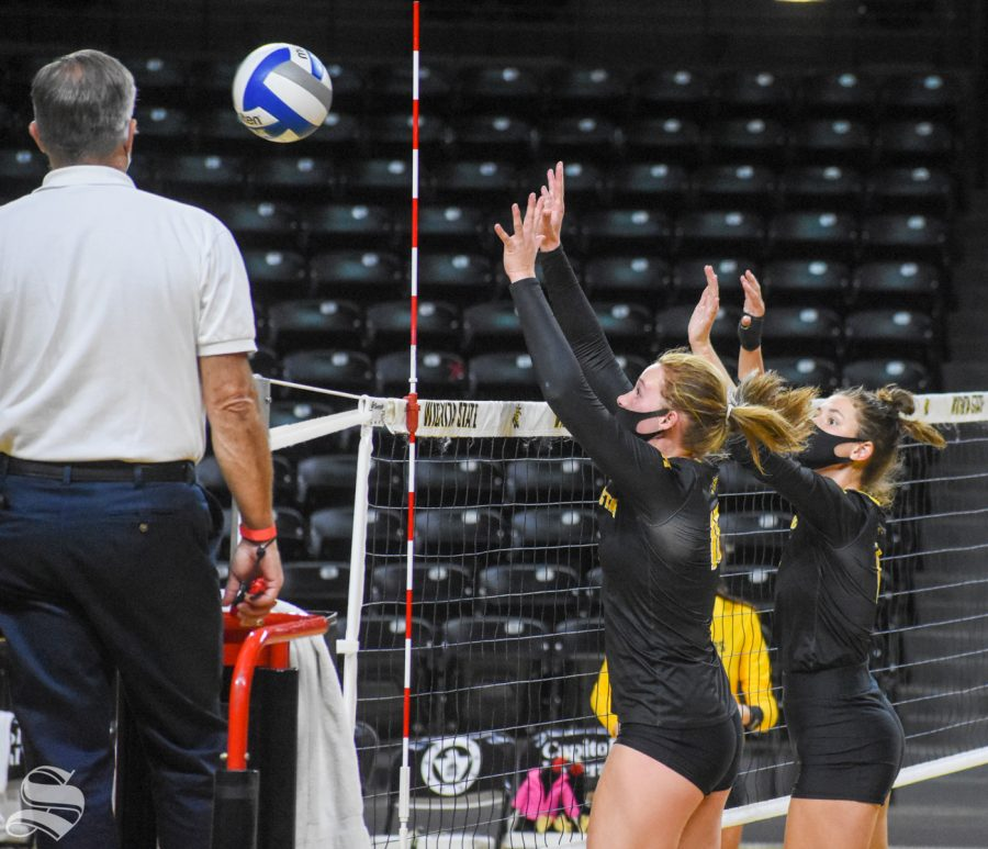 Wichita State freshmen Marriah Buss and Morgan Weber go up for a block against the yellow team during the scrimmage on Friday inside Charles Koch Arena.