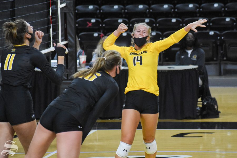 Wichita States McKayla Wuensch celebrates after scoring against the yellow team during the Black and Yellow Scrimmage on Friday, Oct. 16. The black team won in five sets, 3-2.