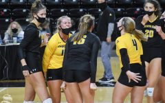 Wichita State's McKayla Wuensch celebrates with her teammates after scoring against the yellow team during the Black and Yellow Scrimmage on Friday, Oct. 16. The black team won in five sets, 3-2.