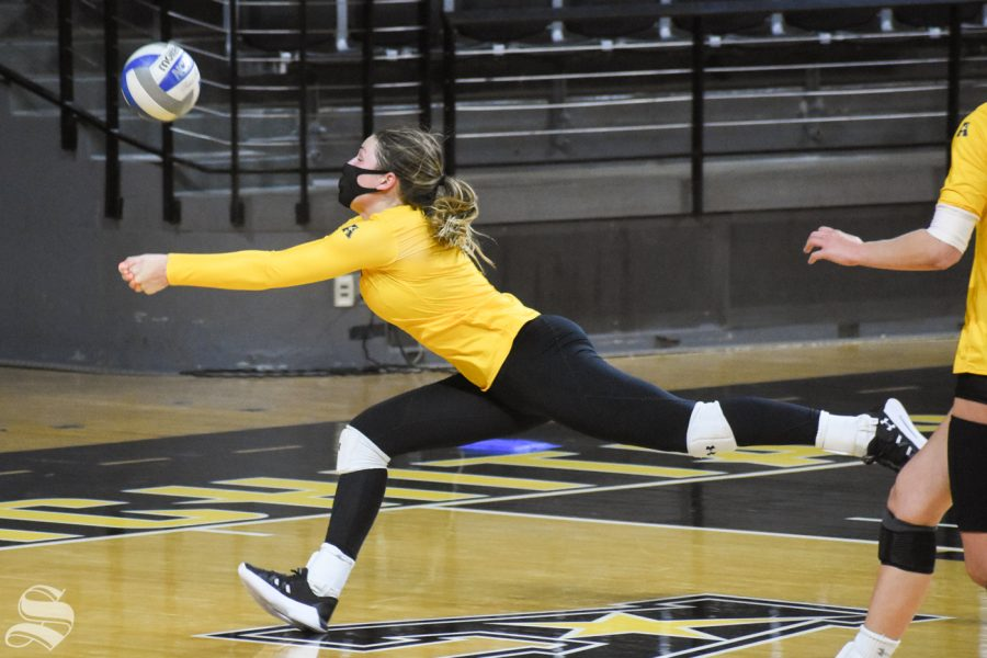 Sophomore Nicole Anderson lunges for a loose ball during the Black and Yellow Scrimmage on Friday, Oct. 16 inside Charles Koch Arena.