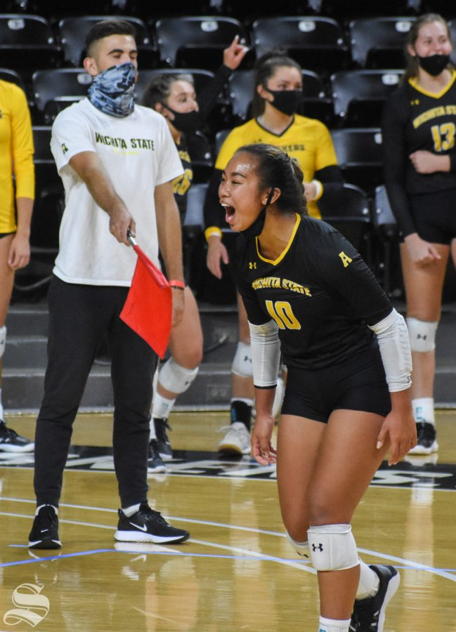 Wichita States Sina Uluave celebrates after scoring against the yellow team during the Black and Yellow Scrimmage on Friday. The black team won the scrimmage, 3-2.