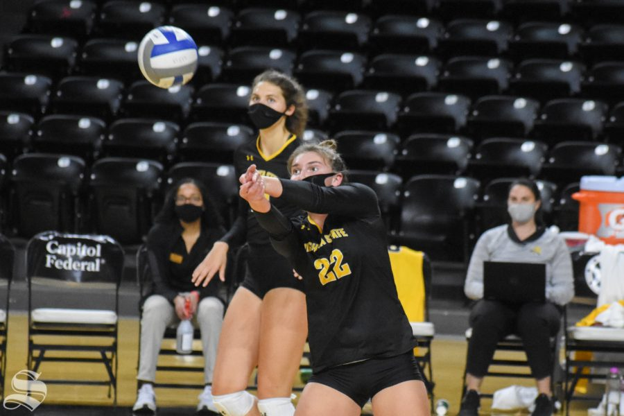Freshman Morgan Weber passes the ball over to the yellow team during the Black and Yellow Scrimmage on Friday, Oct. 16.