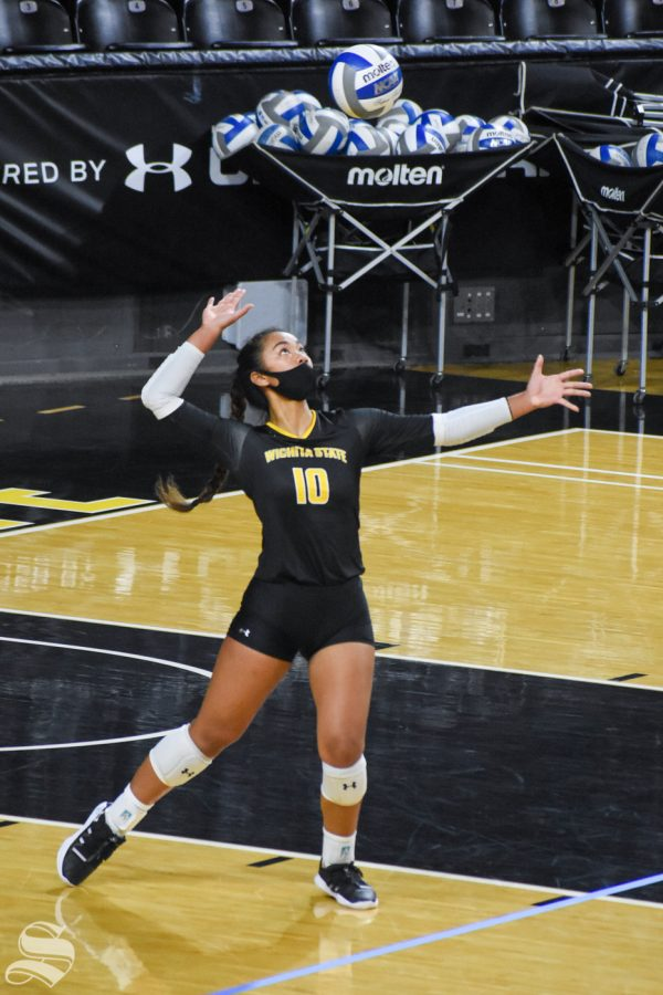 Wichita States Sina Uluave serves the ball to the yellow team during the scrimmage on Friday, Oct. 16 inside Charles Koch Arena.