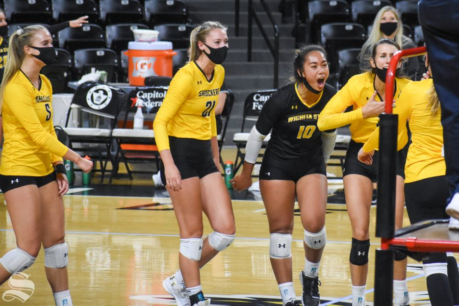 The yellow team celebrates after scoring against the black team during the Black and Yellow Scrimmage on Friday. The black team won the scrimmage, 3-2.