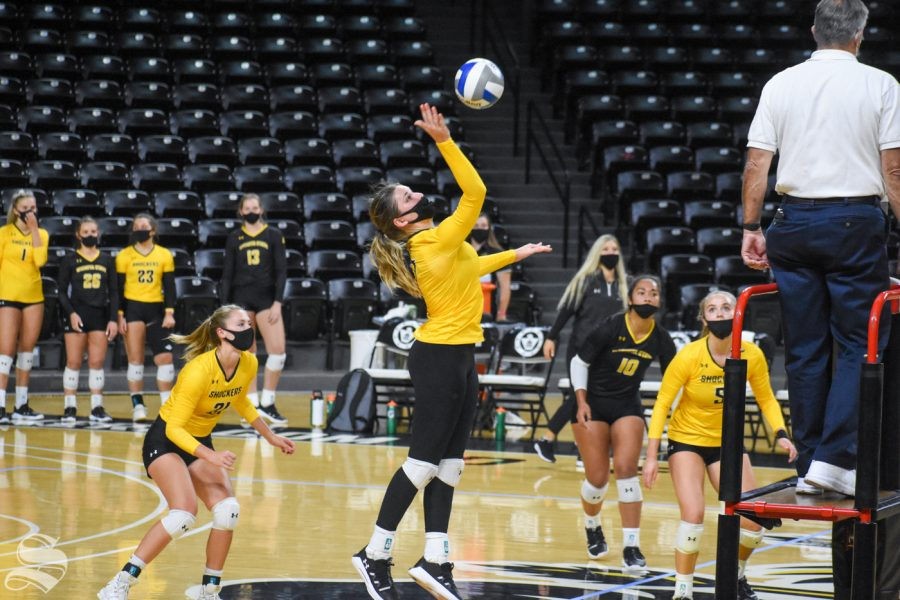 Wichita States Nicole Anderson hits the ball over to the black team during the scrimmage on Friday inside Charles Koch Arena.